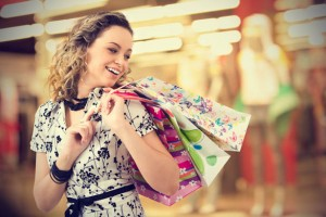happy-woman-holding-her-shopping-bags